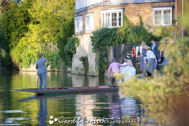 Wedding photography of bride and groom punting