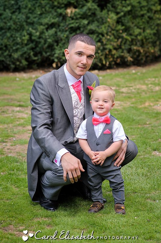 Groom and pageboy with pink ties