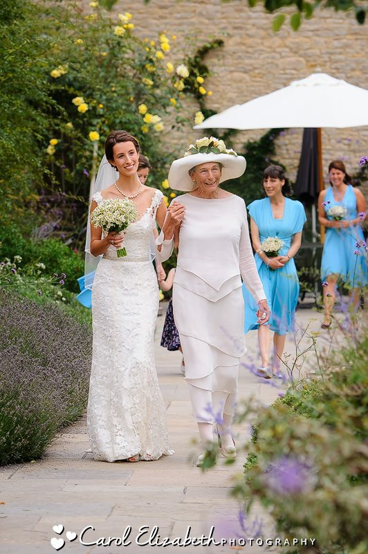 Bride and mum walking down the aisle at Caswell House