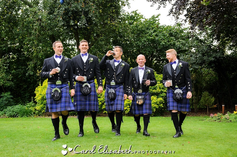 Relaxed photo of groom and ushers with kilts at Steventon House wedding