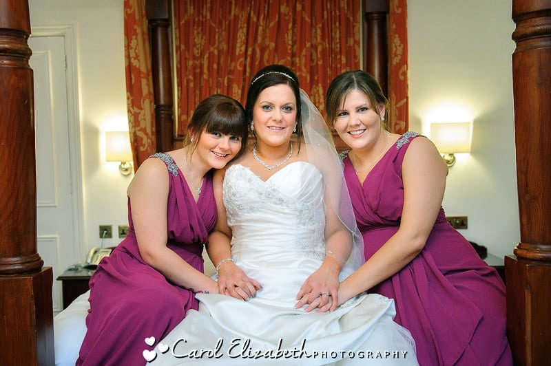 Bride and bridesmaids on a bed
