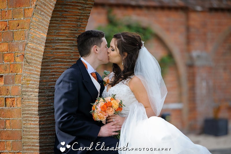 Romantic photo of bride and groom kissing at Milton Hill wedding