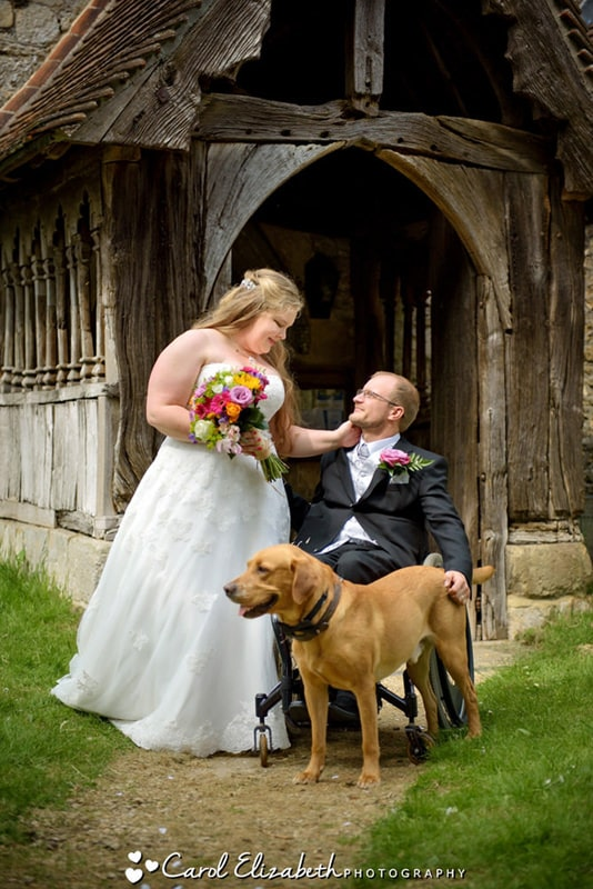 Bride and groom and dog at church wedding