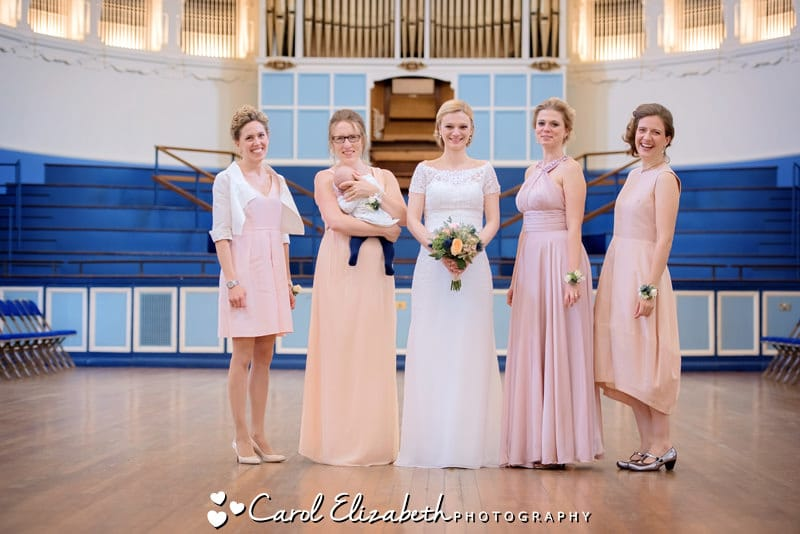 Bride and bridesmaids in different dresses