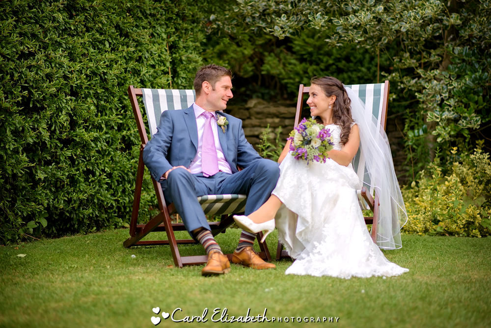 Bride and groom on deckchairs
