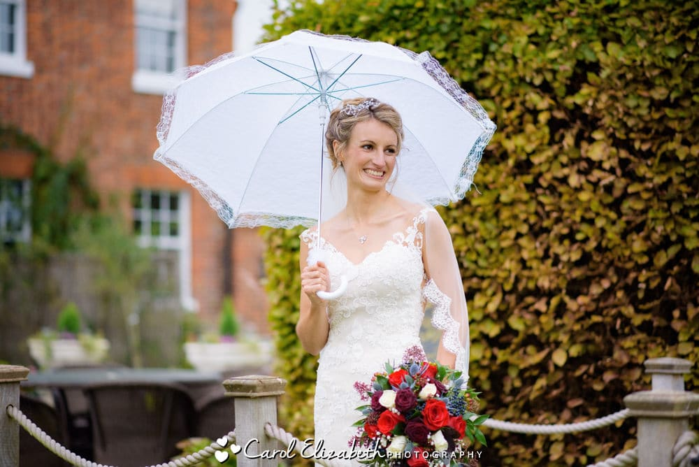 Beautiful bride with umbrella