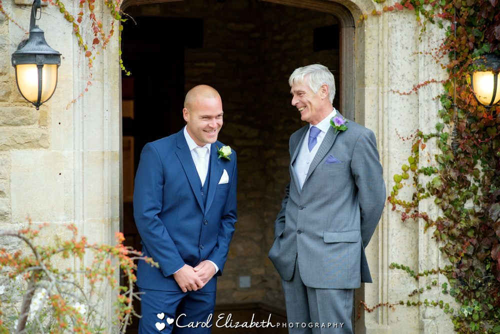 Candid photo of groom and dad at Fosse Manor wedding