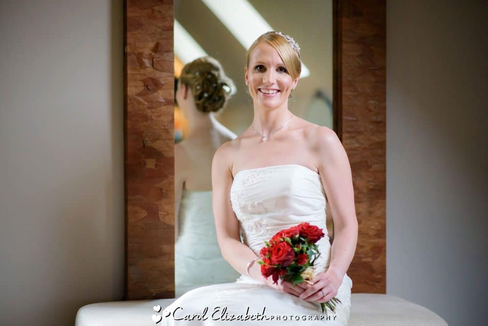 Bride with red roses bouquet