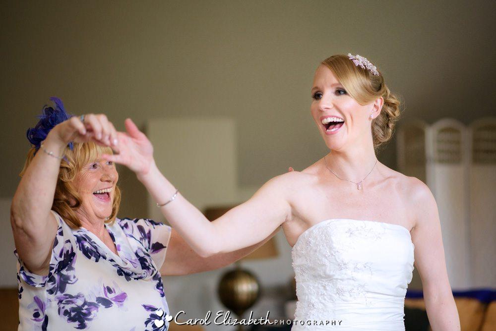 Bride and mum dancing