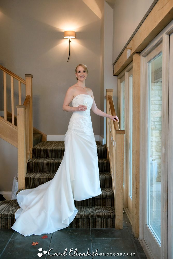 Bride on the staircase at Hyde Barn