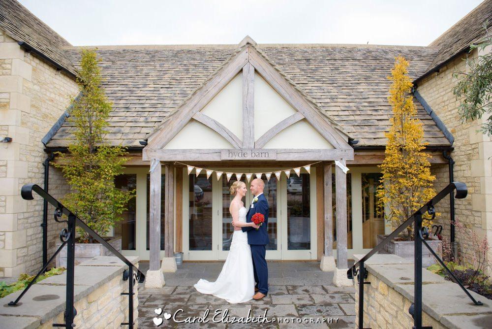 Bride and groom outside Hyde Barn