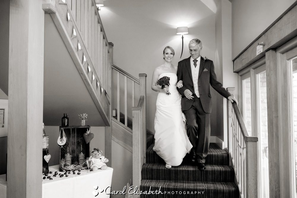 Bride and dad before the ceremony on the staircase at Hyde Barn
