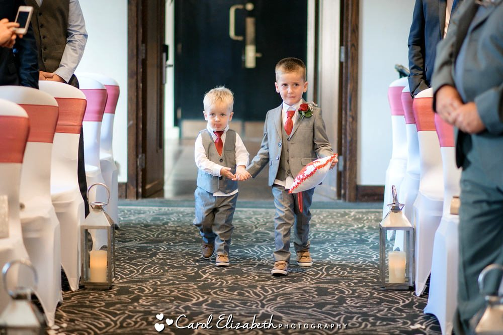 Pageboys walking down the aisle