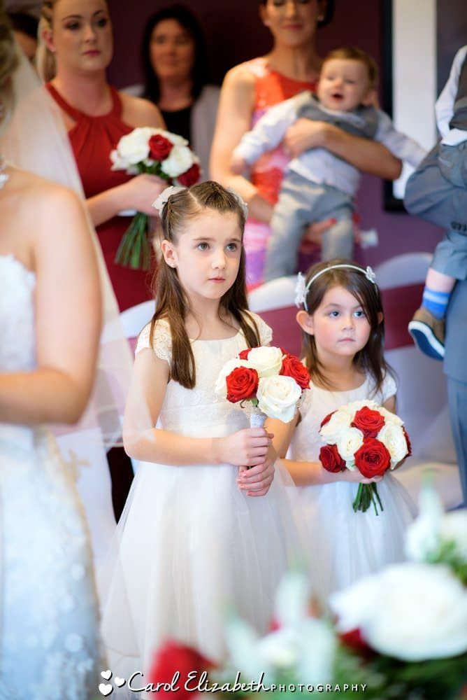 Flowergirls with red and white roses