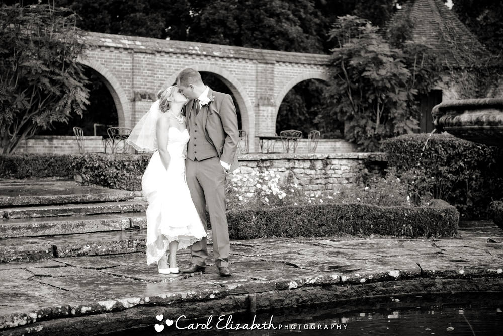 Bride and groom in the Italian Gardens at Milton Hill House Hotel wedding