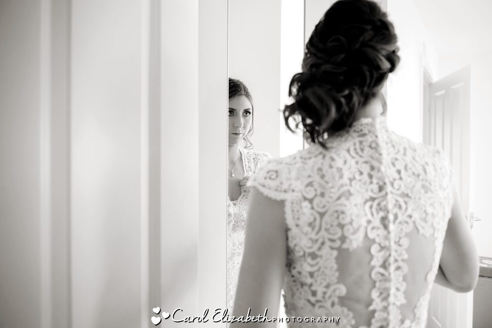 Bridal preparations - bride looking in mirror
