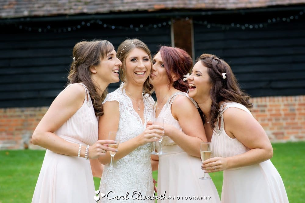 Bride and bridesmaids in a fun photo after the ceremony