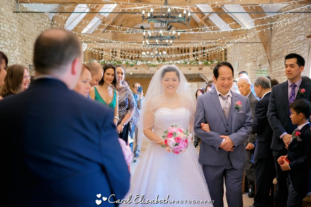 Bride and dad walking down the aisle at Caswell House wedding