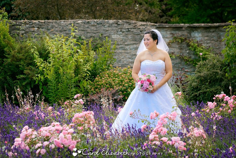 Bride in the flower garden at Caswell House