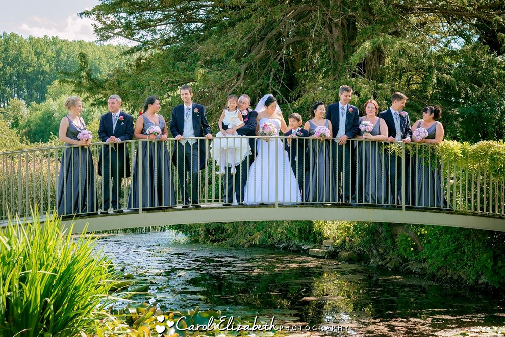 Bride and groom on the bridge at Caswell House