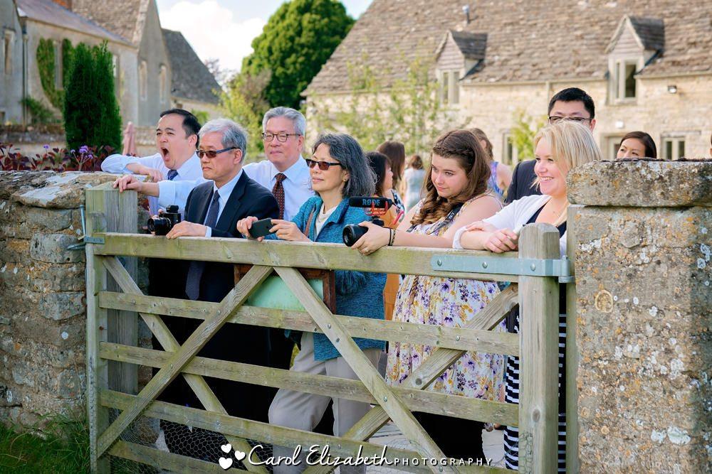 Guests watching wedig photos