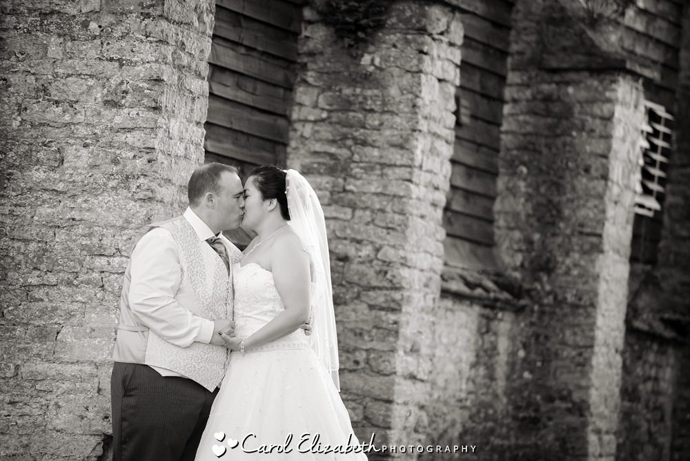Informal wedding photography at Caswell House bride and groom kissing