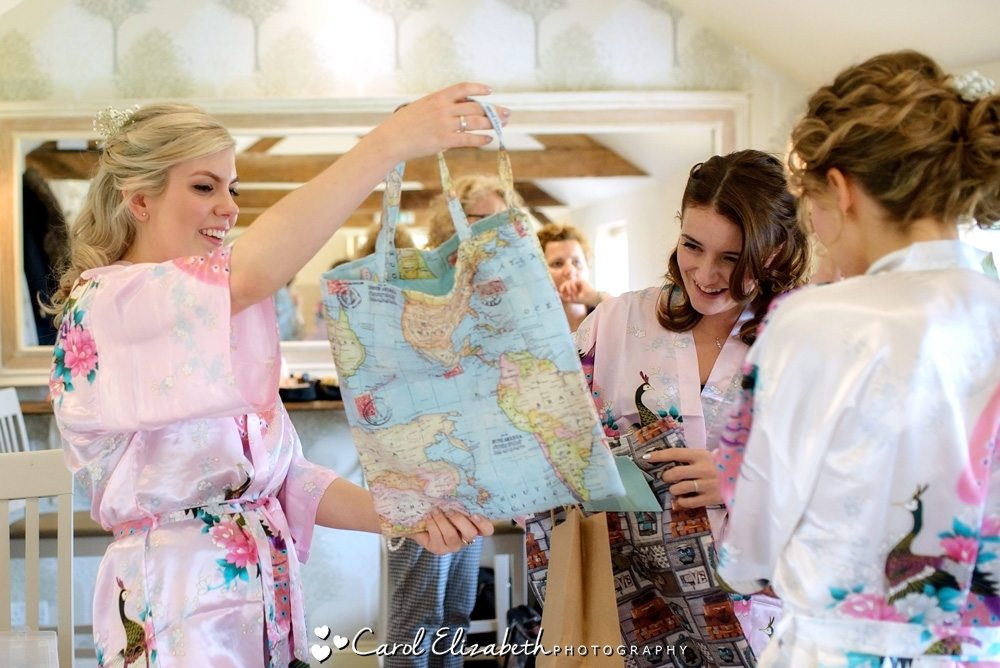 Bridesmaids with gifts before the wedding