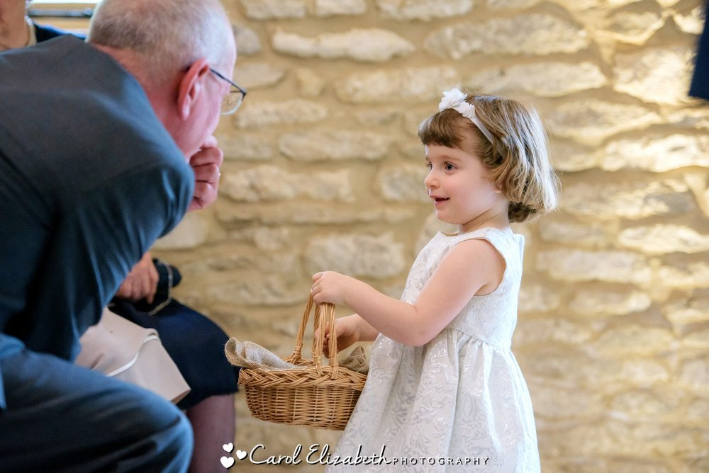 Bridesmaid with basket of confetti