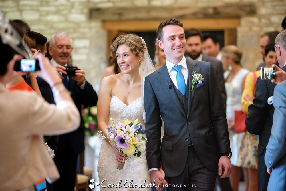 Wedding couple walking down the aisle at Caswell House
