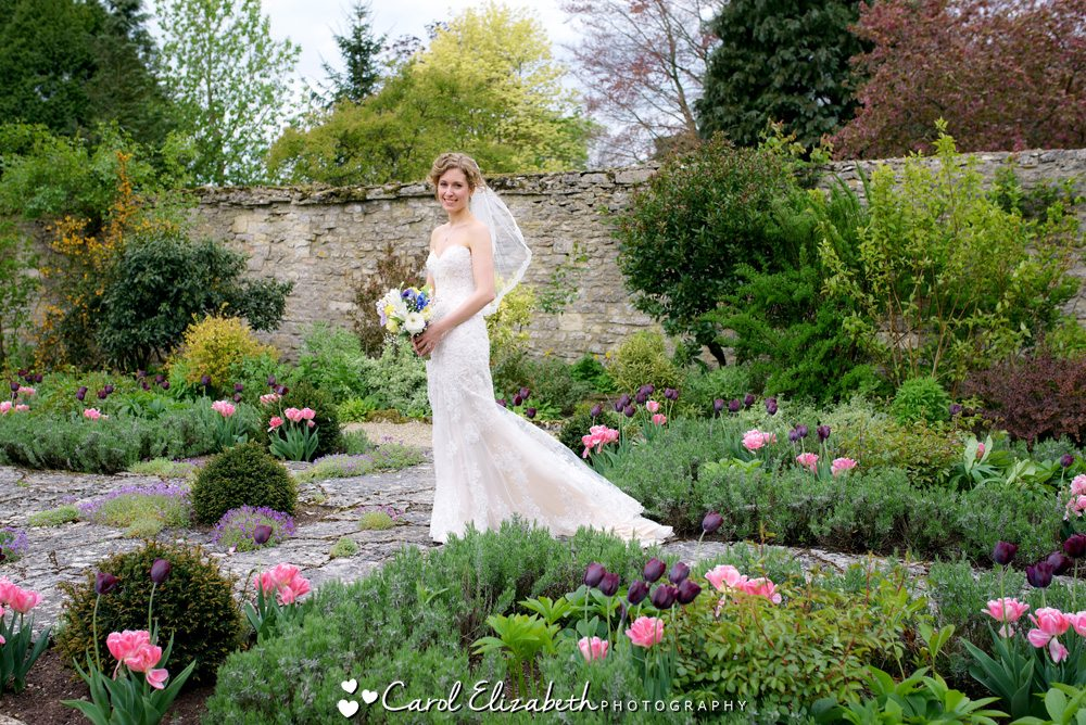 Bride in the gardens at Caswell house