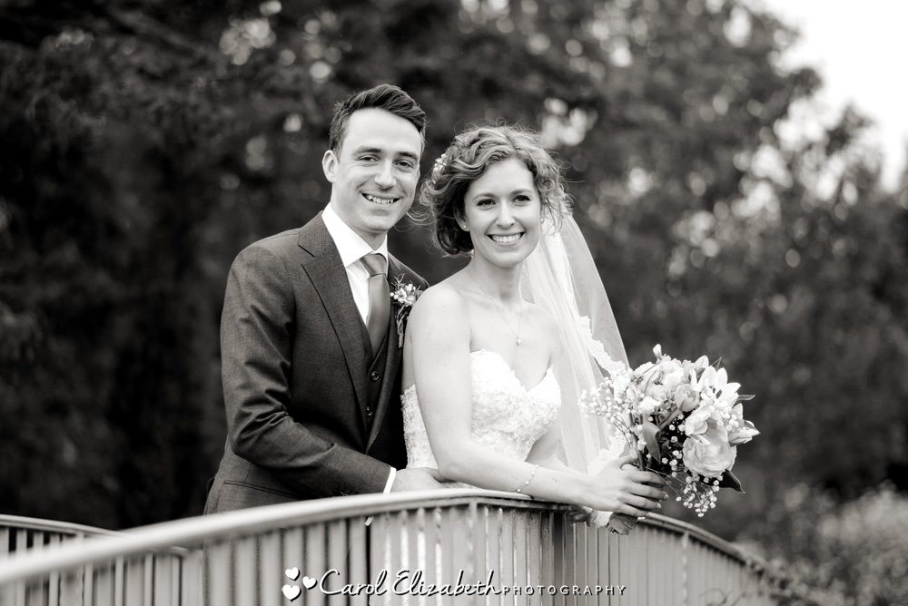 Wedding couple on the bridge at Caswell House