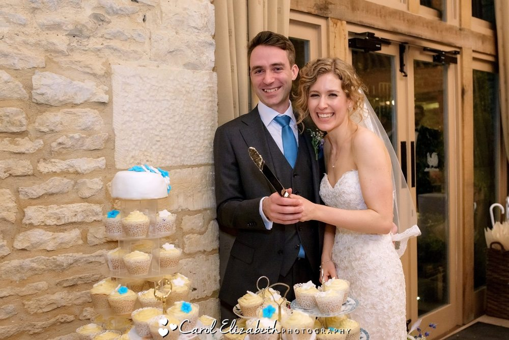 Cutting wedding cake at Caswell House