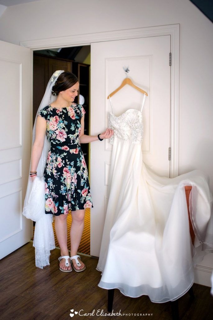 Bride looking at her wedding dress