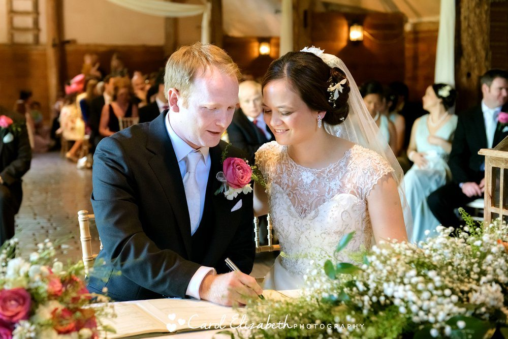 Signing the register at Lains Barn wedding
