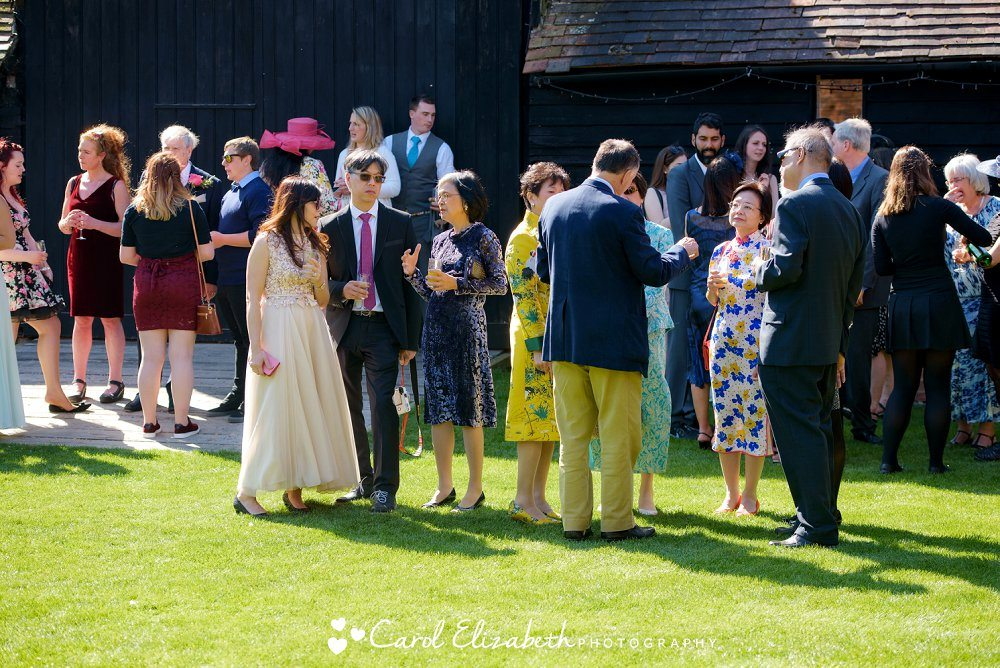 Guests chatting at wedding