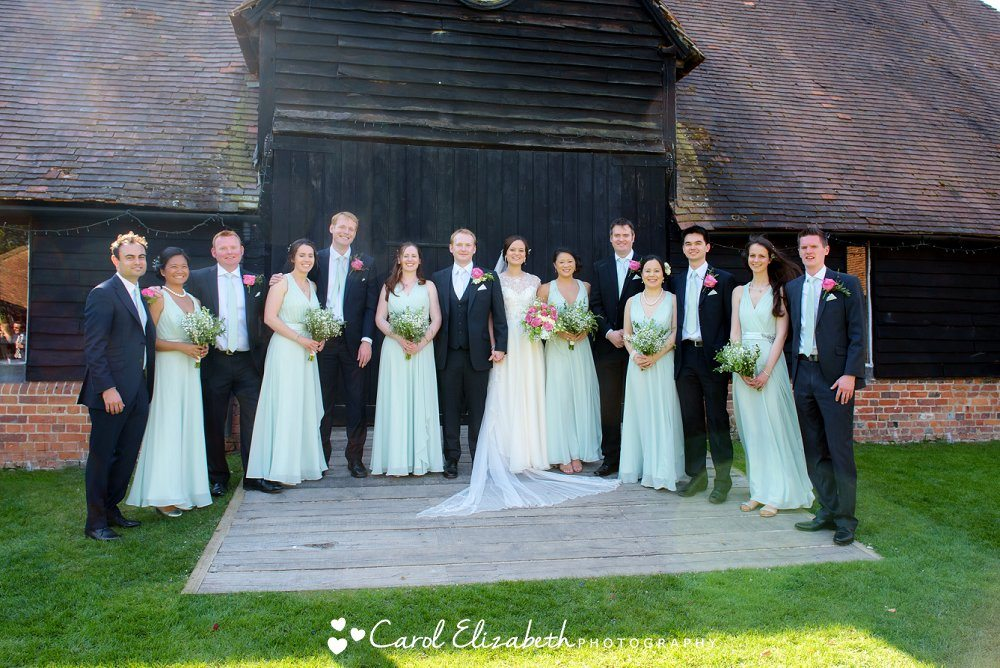 Bridal party outside the main doors at Lains Barn