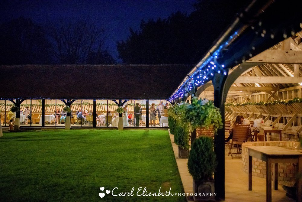 An evening photo of Lains Barn with fairy lights