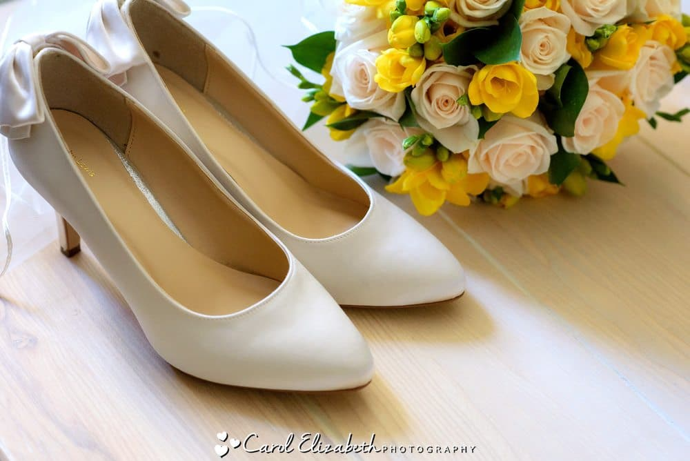Wedding details - shoes and yellow roses