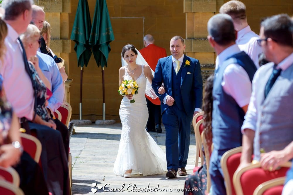 Bride and dad at outdoor Eynsham Hall ceremony