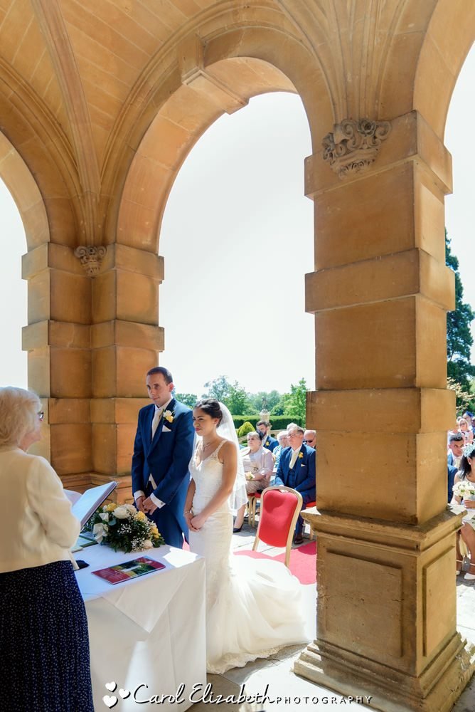 Outdoor wedding ceremony at Eynsham Hall
