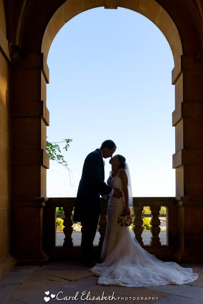 Silhouette of bride and groom at Eynsham Hall