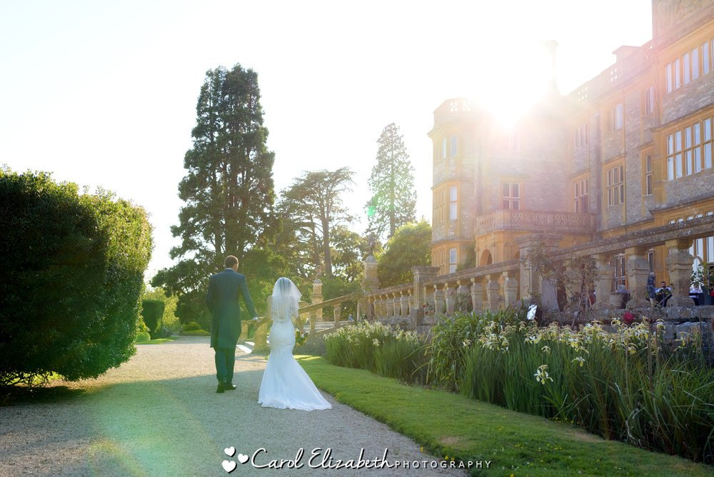 Bride and groom walking at Eynsham Hall