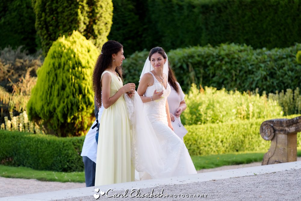 Bride and bridesmaid in the gardens