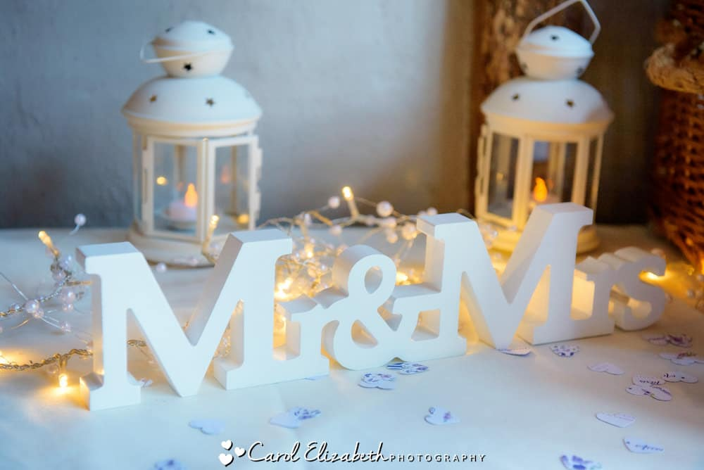 Mr and Mrs with fairy lights