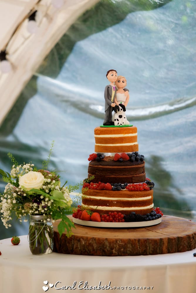 Naked wedding cake with topper