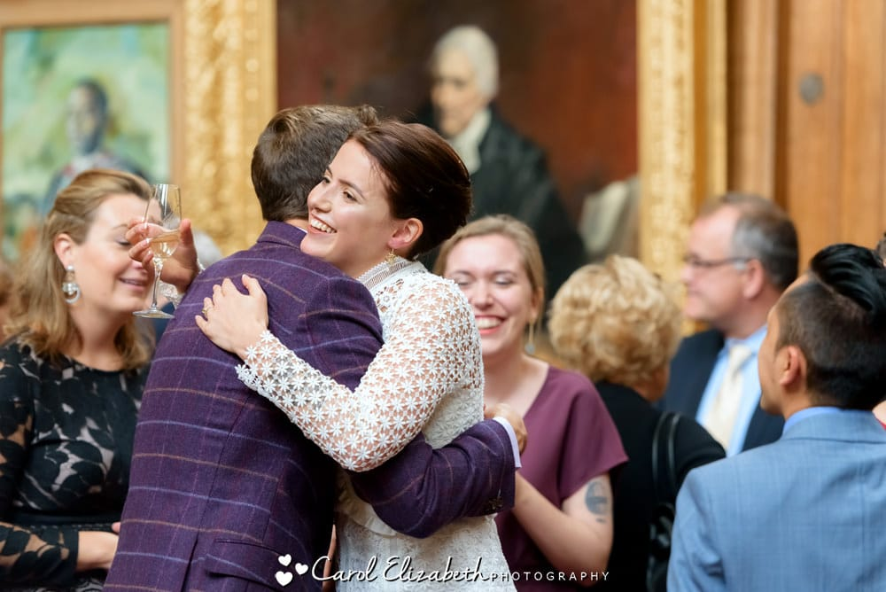 Bride hugging guest at Oxford wedding reception