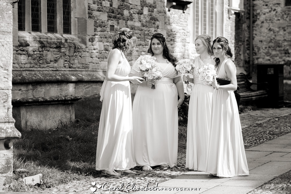 Reportage photo of Bridesmaids outside Wantage church