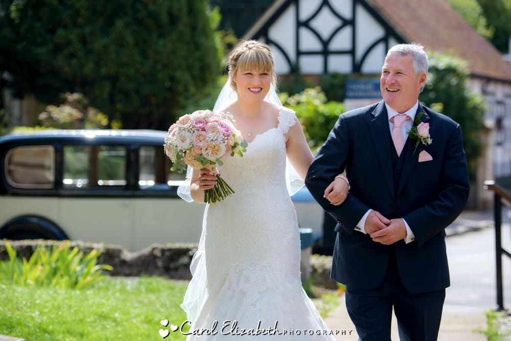 Bride and father arriving at church in Wantage