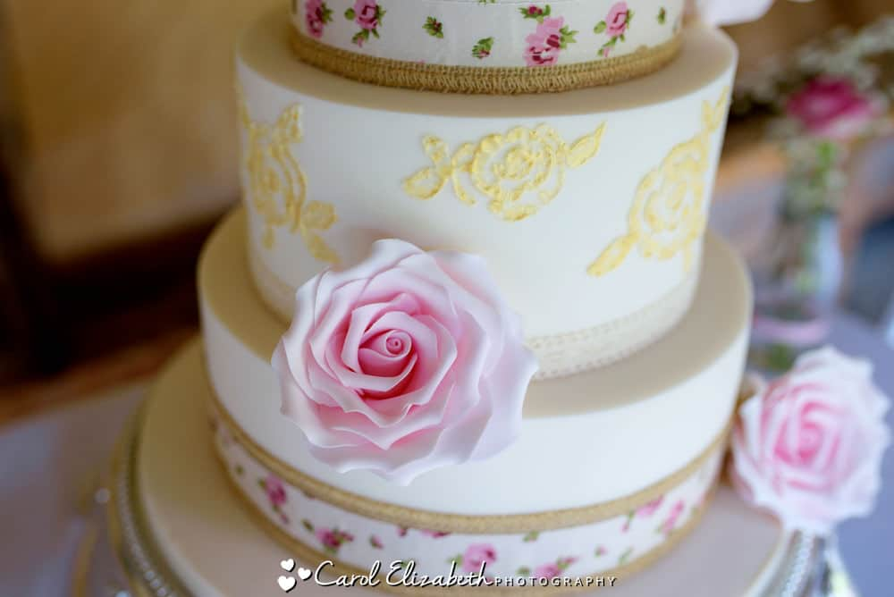 Close-up of wedding cake pink rose