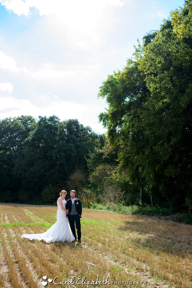 Bride and groom in the field